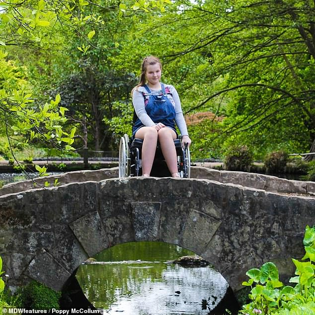 Recalling her first symptoms, Miss McCollum said: 'When I woke up that first day, I thought I had jarred my back from the running I did the day before' (pictured in her wheelchair)