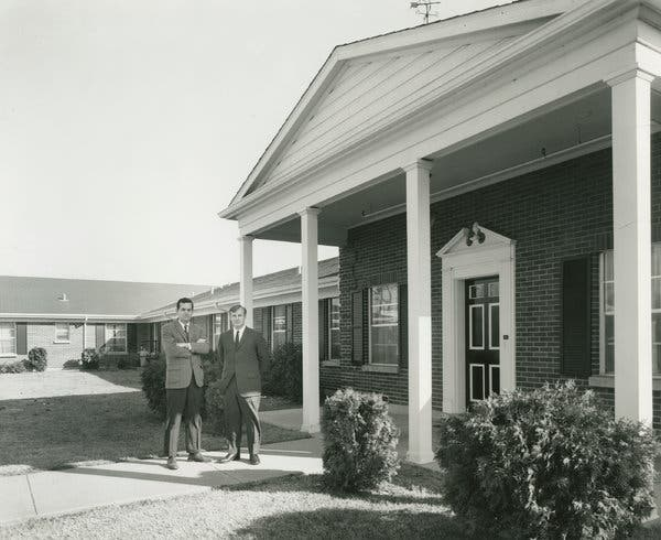 Mr. Cherry and Mr. Jones outside their first nursing home in 1961.