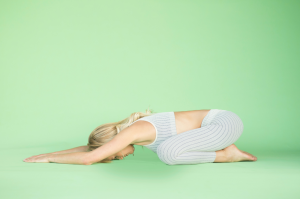 woman doing childs pose