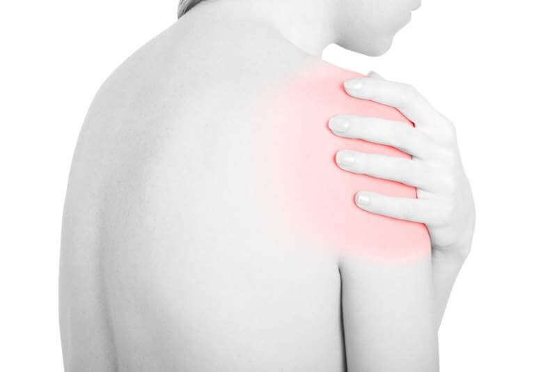 young-woman-touching-her-red-painful-shoulder