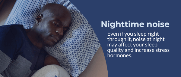 A man sleeps in a comfy bed at night.